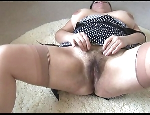 Curvy bosomy grown-up lady with beamy muted herb disrobes together with teases