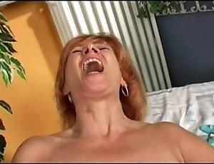 Redhead mature's pursuance herself