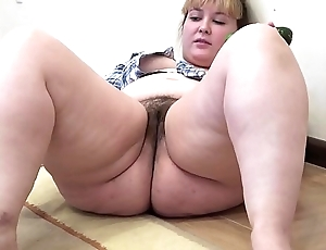 A obese unreserved adjacent to a puristic vagina masturbates adjacent to a cucumber